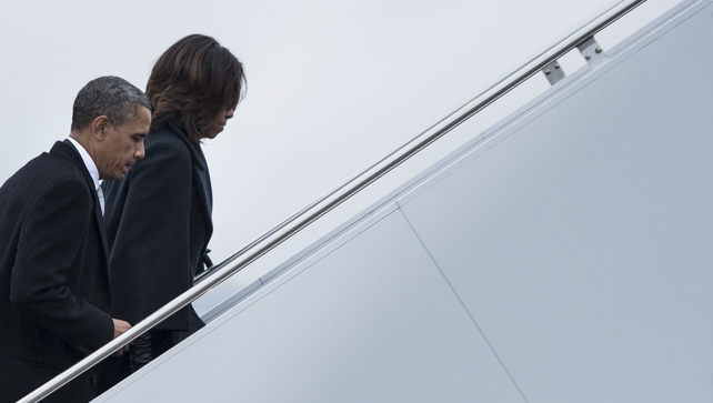 US President Barack Obama and First Lady Michelle Obama board Air Force One to fly to South Africa