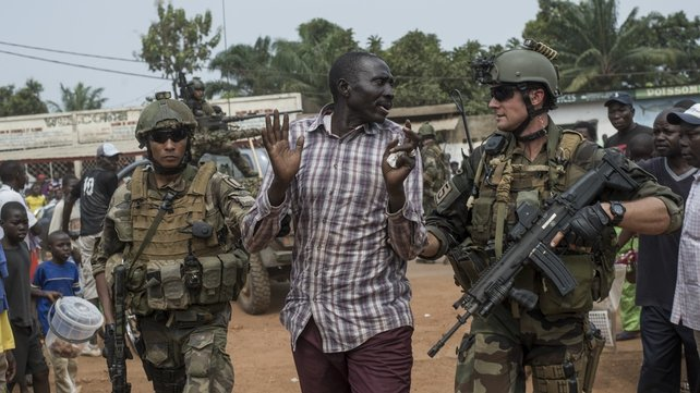 French soldiers arrest a man during a patrol on the streets of the capital Bangui