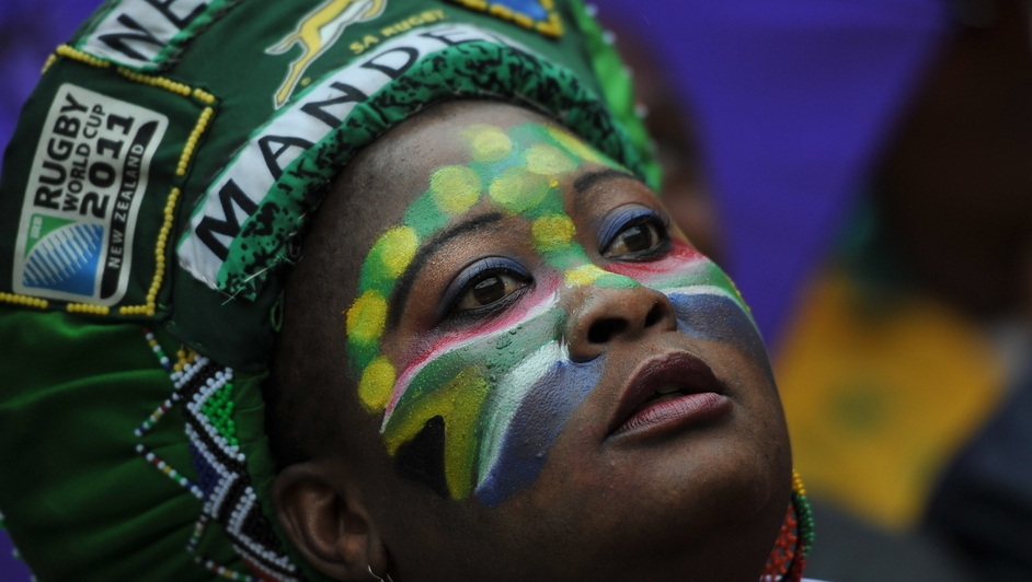 A woman attends the memorial service of former president Mandela