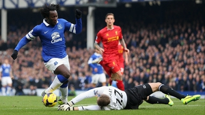 Simon Mignolet saves at the feet of Romelu Lukaku during the Merseyside derby