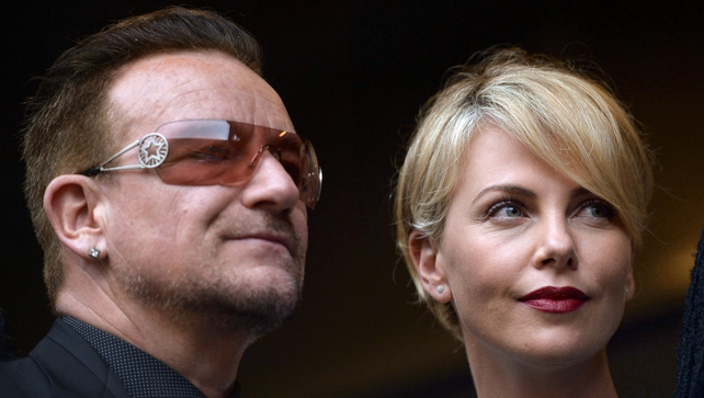 U2 singer Bono and actress Charlize Theron were also among the guests at the memorial