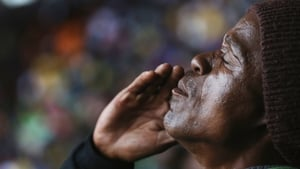A man sings passionately during the memorial service