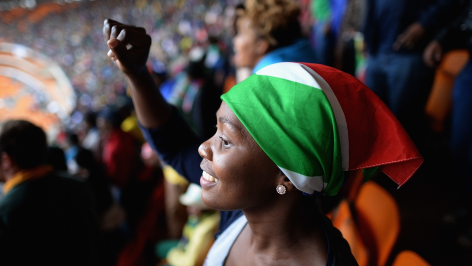 Members of the public sang and danced inside the Soweto Stadium