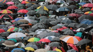 Tens of thousands of people braved torrential rain to attend the event