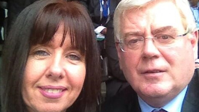 Tánaiste Eamon Gilmore posted a picture of himself at the ceremony with Dunnes striker Liz Deasy