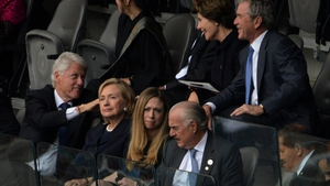 Former US presidents Bill Clinton and George Bush chat at the service - also pictured are Laura Bush, Hillary Clinton and Chelsea Clinton