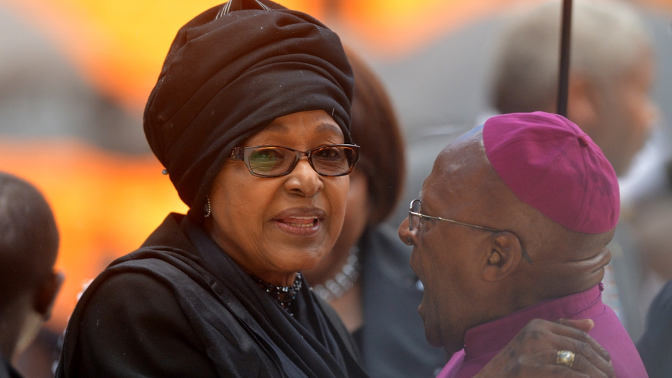 Winnie Mandela and Archbishop Emeritus Desmond Tutu greet each other