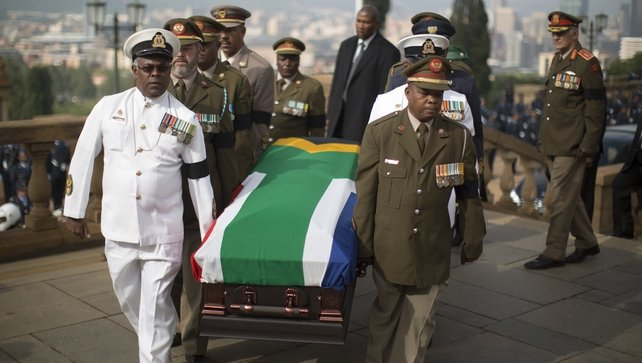 Mr Mandela's flag-draped casket was met by officers representing branches of the military