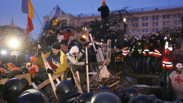 Demonstrators face off with riot police in Kiev