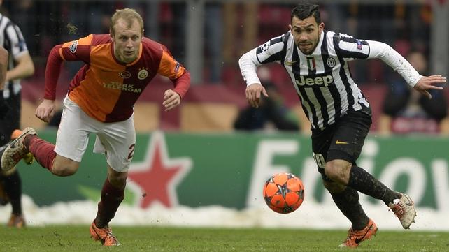 Galatasaray's Semih Kaya (l) with Juventus' Carlos Tevez