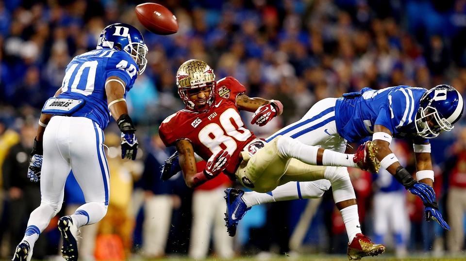 Florida State Seminoles' Rashad Greene misses a catch as Deondre Singleton and Dwayne Norman of Duke Blue Devils defend