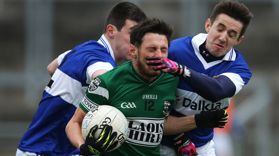Portlaoise's Craig Rogers is tackled by Michael Concarr and Hugh Gill of St Vincent's in the Leinster SFC club final