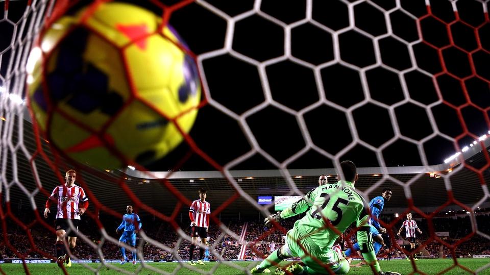 Tottenham's Paulinho shoots past Sunderland goalkeeper Vito Mannone