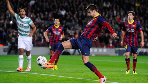 Gerard Pique strikes to give Barcelona an early lead at the Camp Nou