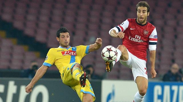 Arsenal's Mathieu Flamini beats Napoli's Blerim Dzemaili to the ball