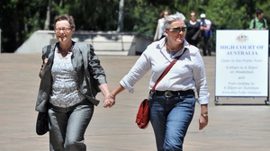 A same-sex couple arrives at the High Court of Australia in Canberra