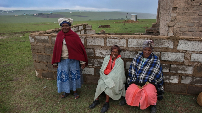 Women sit outside their home in Nelson Mandela's ancestral village of Qunu