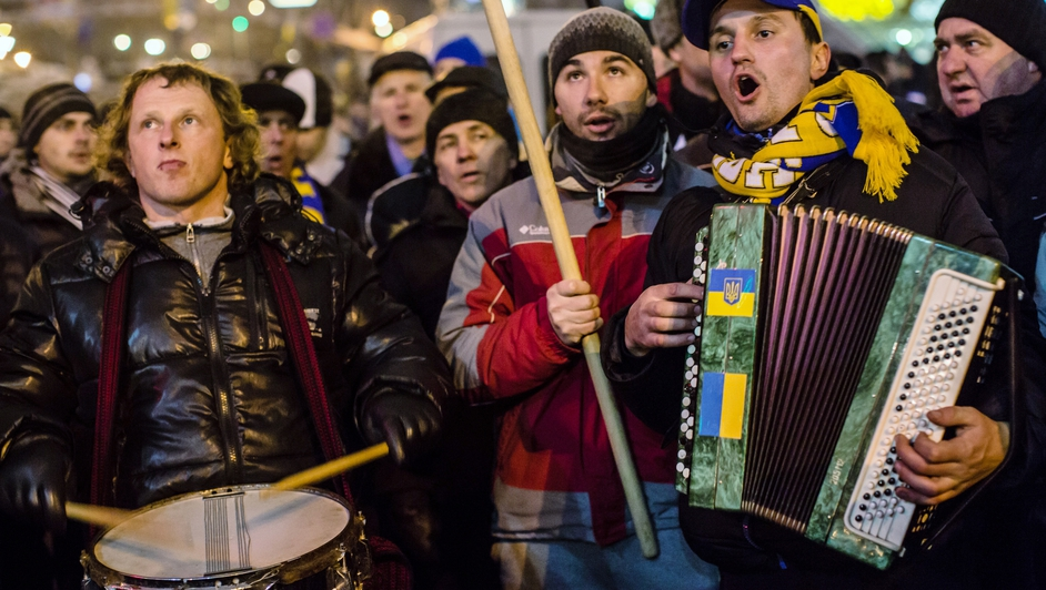 A small band performs while walking around Independence Square during ongoing anti-government protests in Kiev