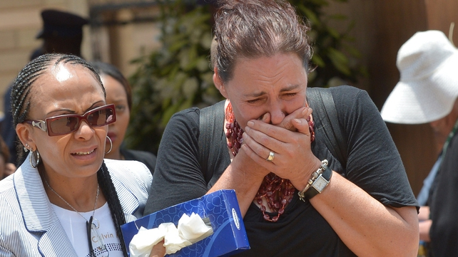 A woman cries after paying her respects to Nelson Mandela