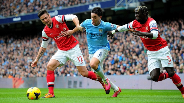 Bacary Sagna (right) will swap the red of Arsenal for the sky blue of Man City next season