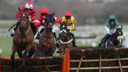 The New One (L) clears the last to win the International Hurdle at Cheltenham