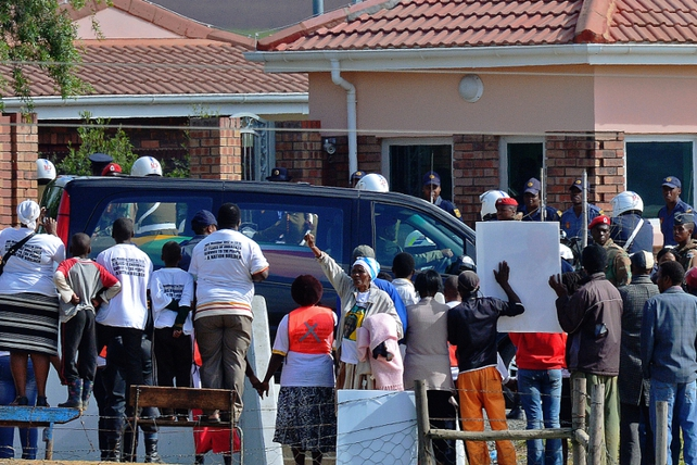 The hearse carrying the remains of South Africa's first black president rolled with a police escort into the hamlet of scattered homes lying between green pastures