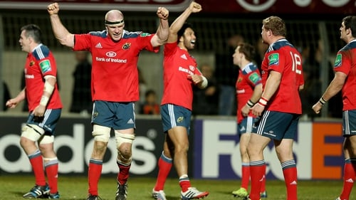 Munster players celebrate after a gruelling victory in Perpignan