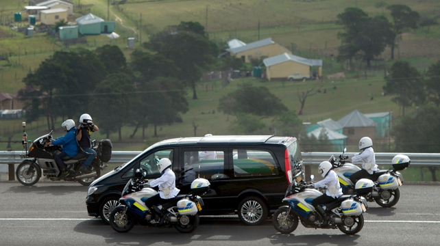 The hearse carrying the remains of South Africa's first black president rolled with a police escort