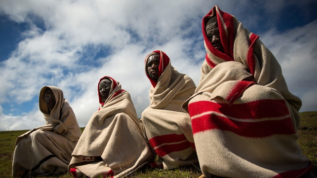 Tembu Xhosa tribe members wait for the arrival of the body of their chief