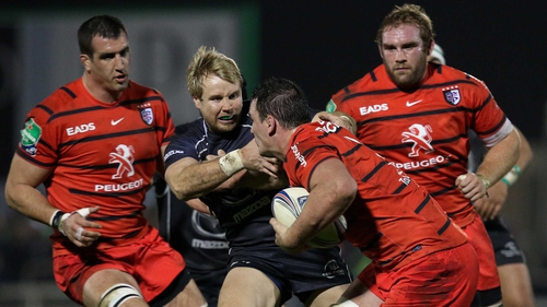 Fionn Carr is tackled by Toulouse's Louis Picamoles