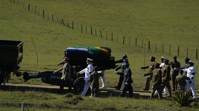 The coffin of South African former president Nelson Mandela is escoted as it arrives for the funeral ceremony in Qunu