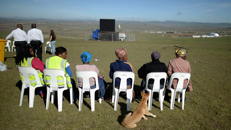 Crowds gathered to watch the ceremony on large screens at the site where Nelson Mandela will be buried