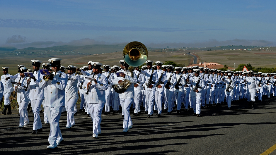 South African armed forces parade as part of the funeral procession
