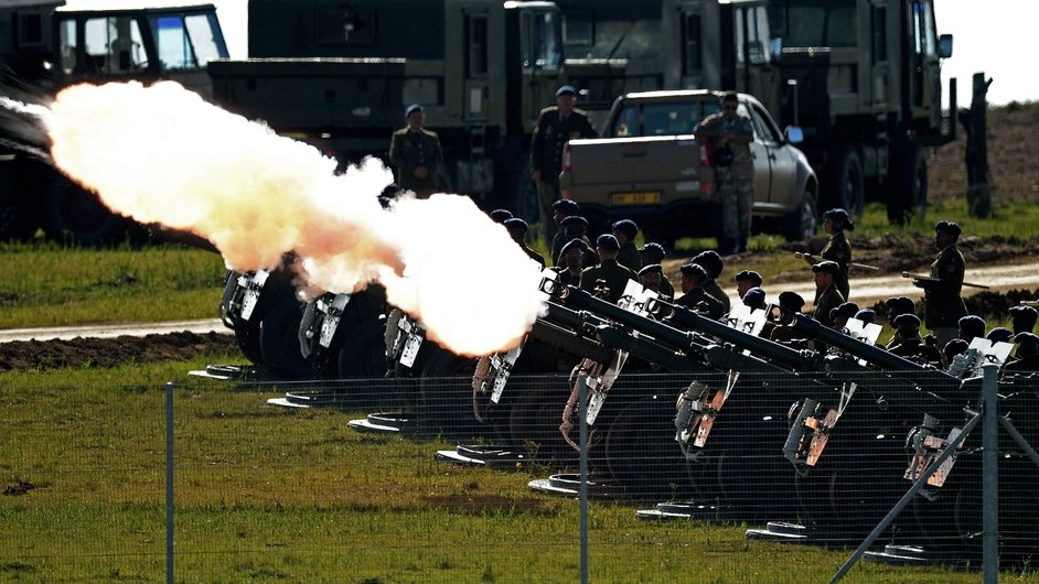 Members of the South African defence forces performing a 21 gun salute