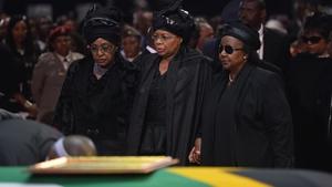 Nelson Mandela's widow Graca Machel and his ex-wife Winnie Mandela Madikizela at the ceremony