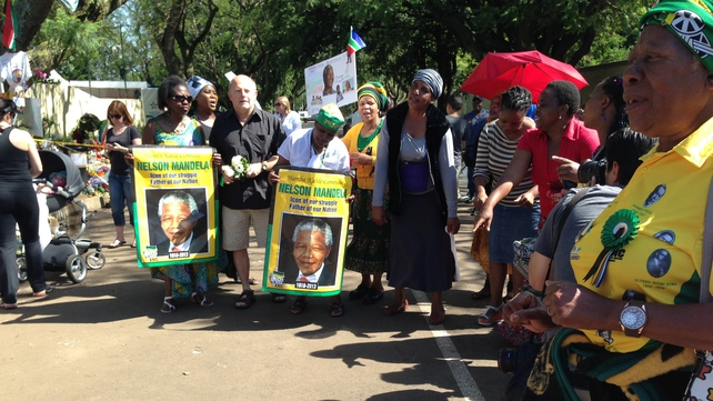 The group of ANC Women's League singing outside Nelson Mandela's home in Johannesburg.