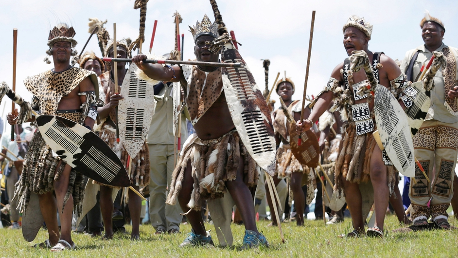 Zulu men perform a traditional dance in the hills above Qunu during  the funeral ceremony
