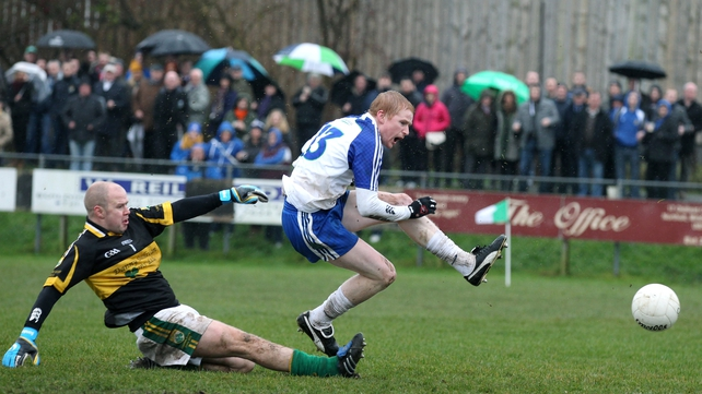 Ballinderry's Collie Devlin scores past Kingdom Kerry Gaels 'keeper Shaun Howard