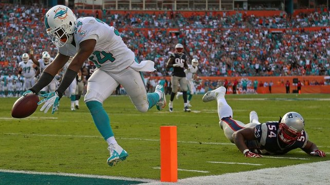 Marcus Thigpen's touchdown secured victory for the Miami Dolphins against the New England Patriots