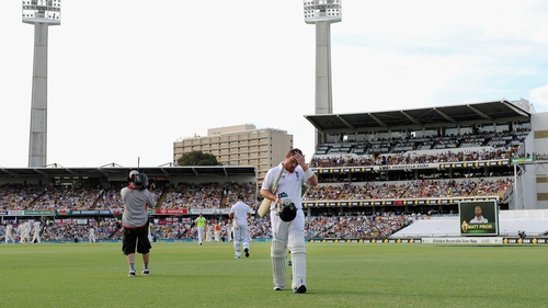 Ian Bell walks off after hitting an impressive 60 as England face an almost impossible task at the WACA