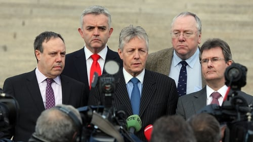 Peter Robinson (centre) remains hopeful an agreement can be reached