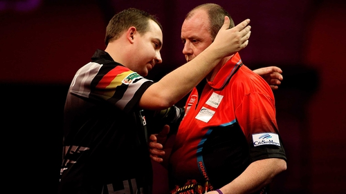 Kim Huybrechts (L) of Belgium embraces his brother Ronny Huybrechts of Belgium (R)