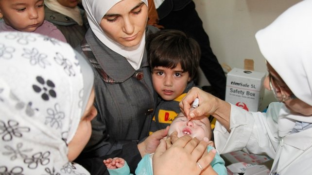 A Syrian child getting the polio vaccine in Damascus last month