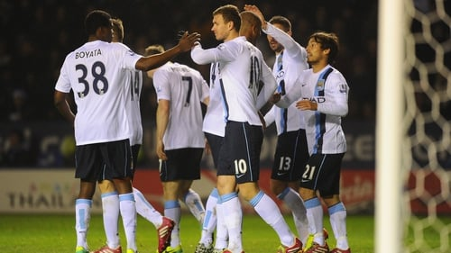 Edin Dzeko celebrates scoring City's third goal against Leicester