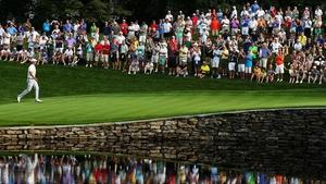 Adam Scott of Australia walks across the 15th green during the PGA Championship in Rochester, New York