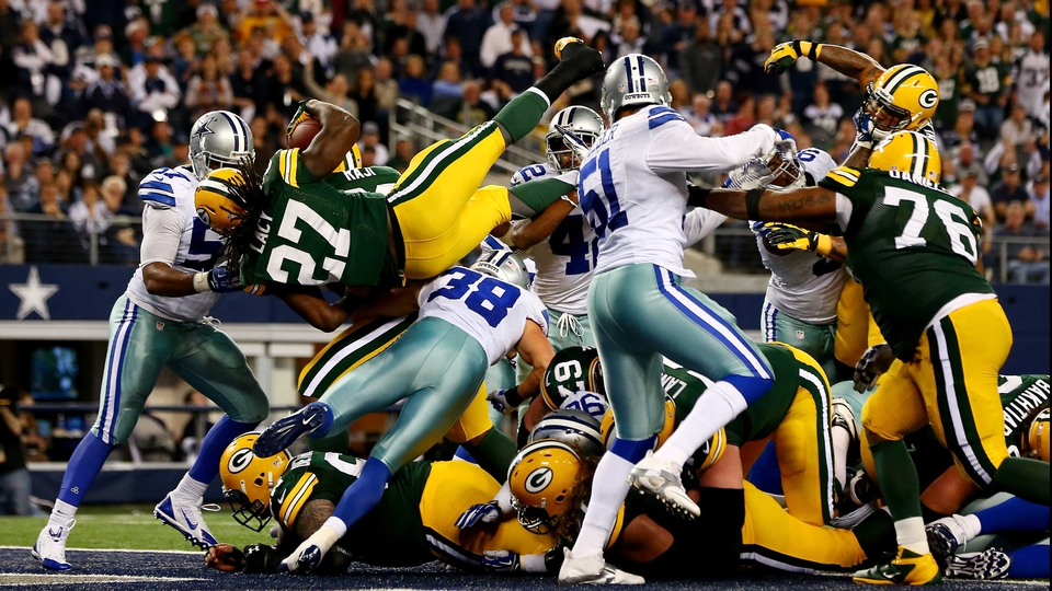 Eddie Lacy (#27) of the Green Bay Packers scores a touchdown against the Dallas Cowboys in Texas