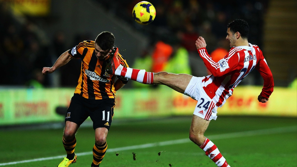 Oussama Assaidi of Stoke puts in a high challenge on Hull's Robbie Brady at the KC Stadium