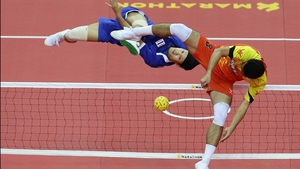 Mohd Hanafiah Dolah attempts to block a Sahachatt Sakhoncharoen strike during the Sepaktakraw Team event at the SEA Games in Nay Pyi Taw, Burma