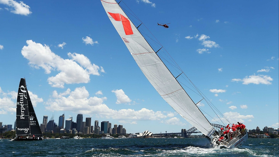 Wild Oates XI follows Perpetual Loyal on the first lap during the 2013 SOLAS Big Boat Challenge at Sydney Harbour