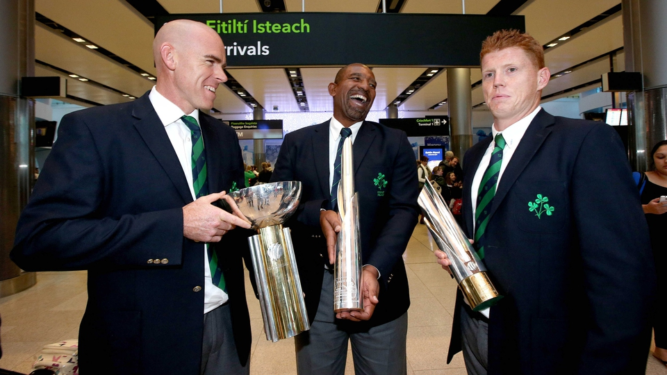 Trent Johnston, Phil Simmons and Kevin O'Brien arrive in Dublin airport with the three international cricket trophies Ireland won this year